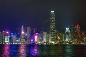 Lights of the city skyline of Central across Victoria Harbour at night in Hong Kong