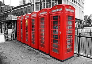 Line of red telephone boxes in London, England, spot colour