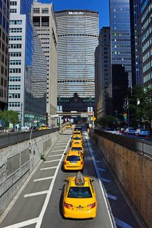 MetLife Building and yellow taxi cabs, New York. America