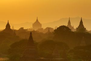 Misty Temples and pagodas at sunset in Bagan, Myanmar (Burma)