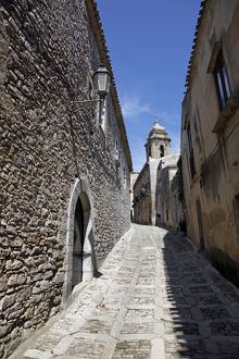 Narrow alley and stone walled street in Erice, Sicily, Italy