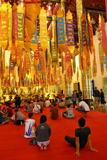 New Year banners and gold Buddha statue inside the Wat Chedi Luang Temple during