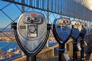 New York Manhattan city skyline and tower viewer telescope binoculars on the Empire