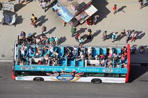 Open top sightseeing tour bus and tourists, Barcelona, Spain