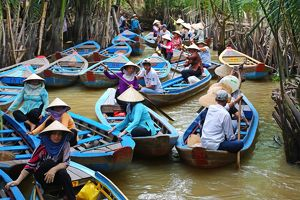 People on Sampan boats on canals on Con Lan (Unicorn) Island, near My Tho, Mekong Delta