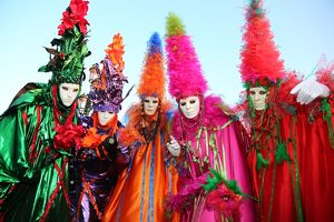 People wearing masks and costumes at the Venice Carnival