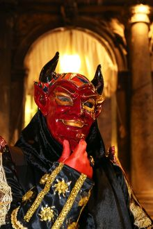 Person wearing a demon mask and costume at the Venice Carnival