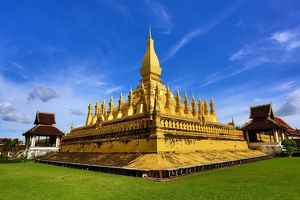Pha That Luang golden Stupa, Vientiane, Laos with blue sky