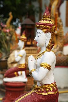 Praying statue at Wat Lam Chang Temple in Chiang Mai, Thailand
