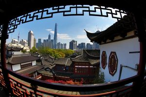 The Pudong city skyline in Shangha in the background of the Yuyuan gardens in the Old City