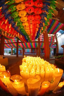 Rainbow coloured paper lanterns and candles at an altar in Bongeunsa Temple in Seoul