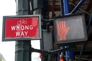 Red don't walk street sign and wrong way sign, New York City, New York, USA