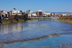 River Kamo and general city view of Kyoto, Japan
