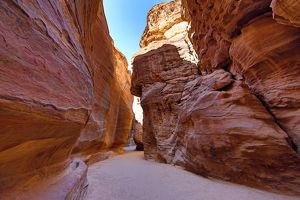 Sandstone cliiffs of the Siq canyon entrance to the city of Petra, Jordan