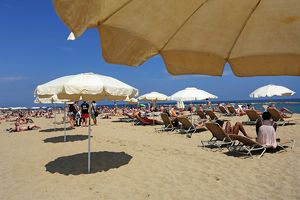 Scene of holiday crowds on the beach, Barcelona, Spain