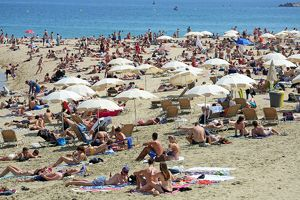 Scene of holiday crowds on the crowded beach, Barcelona, Spain