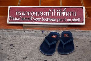 Take of your shoes sign at Wat Chedi Luang temple in Chiang Mai, Thailand