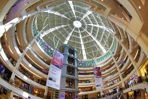 Shops and ceiling at Suria KLCC city centre shopping mall in Kuala Lumpur, Malaysia