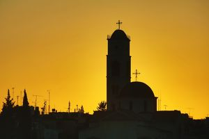 Silhouette of the Greek Orthodox Church dome and tower at sunset in Amman, Jordan