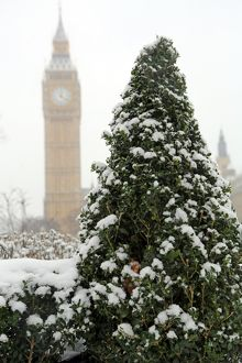 Snow in Parliament Sqaure, the Houses of Parliament and Big Ben, London