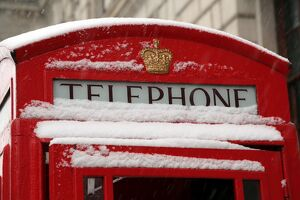 Snow on a red telephone box, London