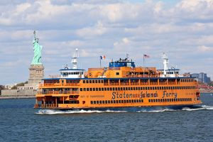 The Staten Island Ferry and the Statue of Liberty, New York. America