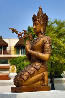 Statue at the City Pillar Shrine at Wat Chedi Luang Temple in Chiang Mai, Thailand