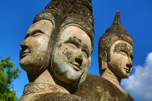 Statues of Buddha heads and faces at the Buddha Park, Vientiane, Laos
