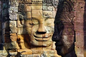 Stone face in the ruins of the Bayon Khmer Temple, Angkor Thom , Siem Reap, Cambodia