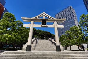 Stone Torii gate and office buildings outside the Hie-Jinja Shinto Shrine, Tokyo, Japan