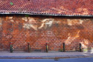 Street scene with old brick wall with light reflection in Copenhagen, Denmark