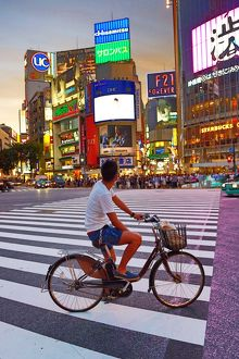 Sunset at the pedestrian crossing at the intersection in Shibuya, Tokyo, Japan