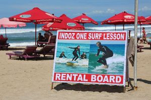 Surf lesson and board rental sign, tourist activities on Legian Beach, Denpasar,Bali