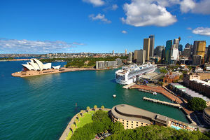 Sydney city skyline, harbour, Opera House and a cruise ship, Sydney, New South Wales