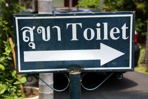 Toilet sign in Thai at Wat Phra Singh Temple in Chiang Mai, Thailand