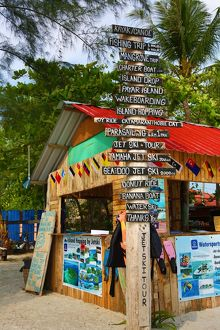 Tourist activities signs and hut on the beach in Pantai Cenang, Langkawi, Malaysia