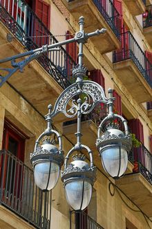 Traditional glass and metal street lamps in Barcelona, Spain