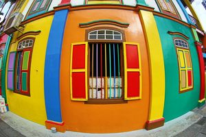 Traditional rainbow coloured house with colourful windows and shutters in Little India in Singapore
