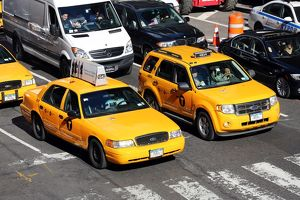 Yellow taxi cabs driving in the street, New York. America