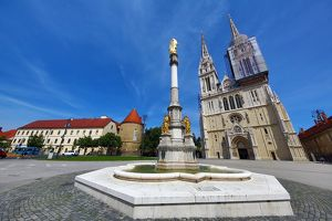 Zagreb Cathedral with tower renovation and Holy Mary Monument column in Zagreb, Croatia